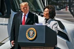President Donald Trump listens as Secretary of Transportation Elaine Chao speaks during an event celebrating American truckers, at the White House, Thursday, April 16, 2020, in Washington