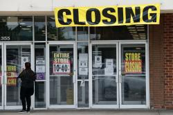 A woman walks into a closing Gordmans store, Thursday, May 28, 2020, in St. Charles, Mo. Stage Stores, which owns Gordmans, is closing all its stores and has filed for Chapter 11 bankruptcy