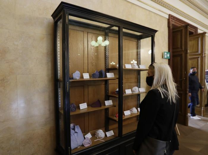 Visitor views an exhibition of face masks at the National Museum in Prague, Czech Republic, Thursday, May 28, 2020