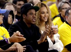 Jay-Z and Beyonce watch Game 1 of an NBA basketball second-round playoff series between the Golden State Warriors and the New Orleans Pelicans in Oakland, Calif.