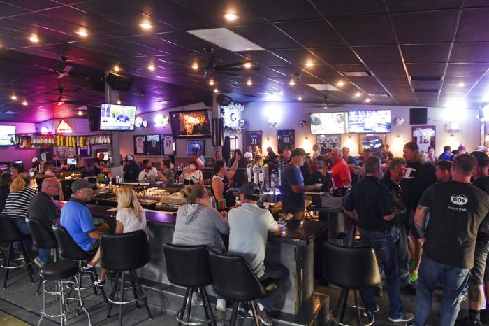 Patrons fill the Crow Bar on the first night of its reopening after interior renovations Thursday, June 18, in Sioux Falls.