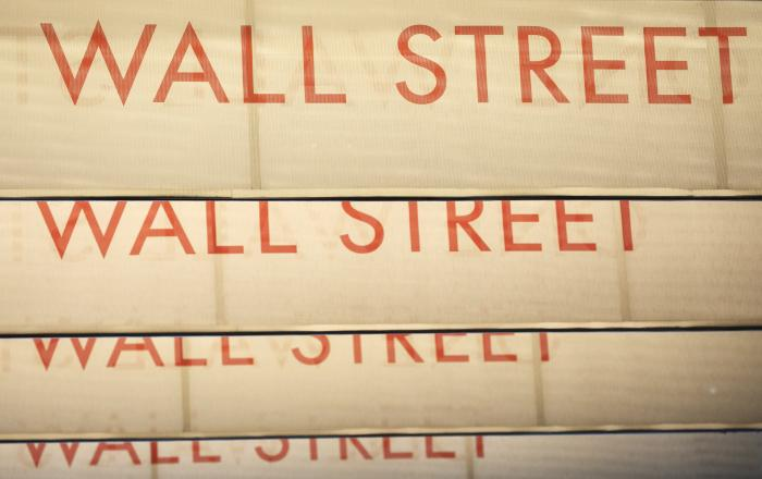 Signs for Wall Street are shown, Thursday, July 30, 2020, in New York