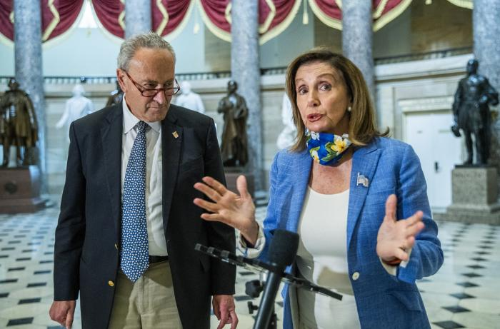 House Speaker Nancy Pelosi of Calif., with Senate Minority Leader Chuck Schumer of N.Y.,