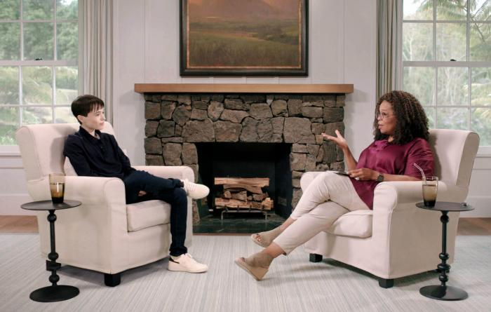 """Elliot Page, left, with Oprah Winfrey during an episode of """"The Oprah Conversation,"""" an interview series on Apple TV+."""
