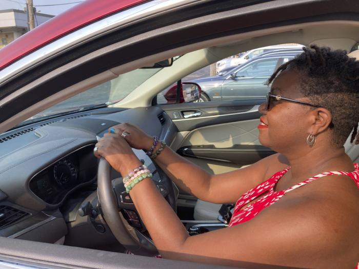 Jessica Pitts sits behind the wheel of a 2019 Lincoln MKC on the lot of Jack Demmer Lincoln in Dearborn, Mich., on Monday, July 19, 2021
