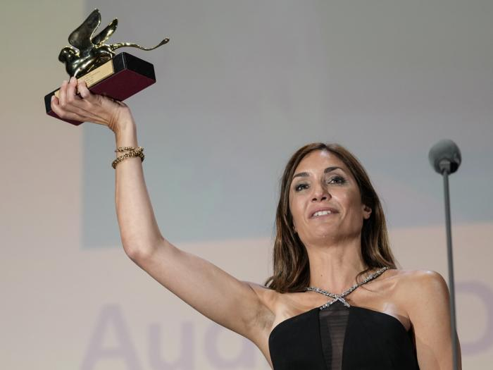 Audrey Diwan holds the Golden Lion award for 'Happening' onstage at the closing ceremony during the 78th edition of the Venice Film Festival in Venice, Italy, Saturday, Sept. 11, 2021.